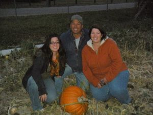 Diana, Tim & Sue picking our Pumpkin for the year!